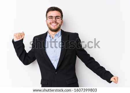 Young caucasian business man posing in a white background isolated Young caucasian business man dancing and having fun.