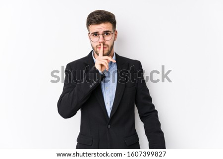 Young caucasian business man posing in a white background isolated Young caucasian business man keeping a secret or asking for silence.
