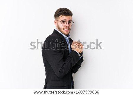 Young caucasian business man posing in a white background isolated Young caucasian business man scared and afraid.