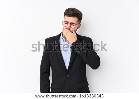Young caucasian business man posing in a white background isolated Young caucasian business man yawning showing a tired gesture covering mouth with hand.