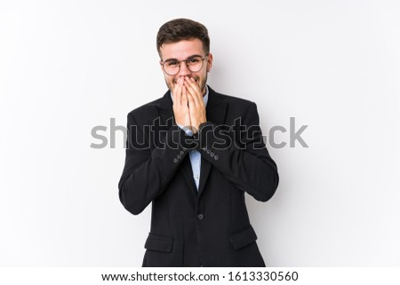 Young caucasian business man posing in a white background isolated Young caucasian business man laughing about something, covering mouth with hands.