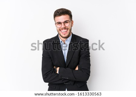 Young caucasian business man posing in a white background isolated Young caucasian business man laughing and having fun.