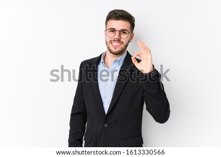 Young caucasian business man posing in a white background isolated Young caucasian business man cheerful and confident showing ok gesture.