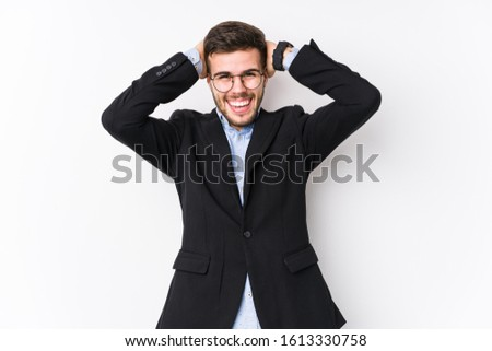 Young caucasian business man posing in a white background isolated Young caucasian business man laughs joyfully keeping hands on head. Happiness concept.