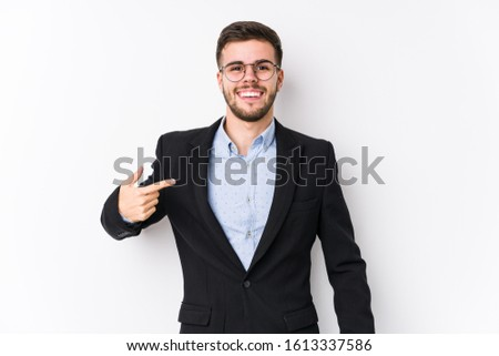 Young caucasian business man posing in a white background isolated Young caucasian business man person pointing by hand to a shirt copy space, proud and confident