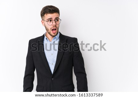Young caucasian business man posing in a white background isolated Young caucasian business man being shocked because of something she has seen.