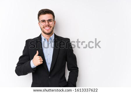 Young caucasian business man posing in a white background isolated Young caucasian business man smiling and raising thumb up