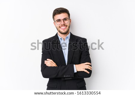 Young caucasian business man posing in a white background isolated Young caucasian business man who feels confident, crossing arms with determination.