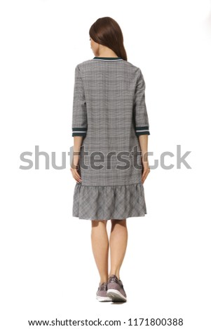 young caucasian business woman executive posing in bomber checked dress high heels stiletto shoes full body length isolated on white back view
