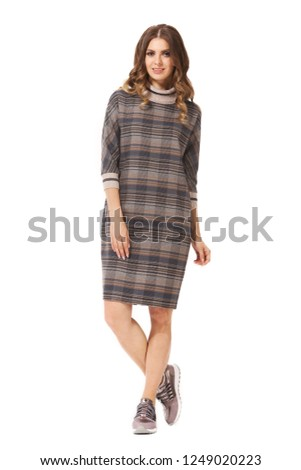 young caucasian business woman executive posing in official woolen checked dress sneakers shoes full body length isolated on white