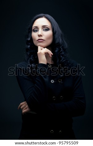 young caucasian confident brunette posing in the studio, - stock photo