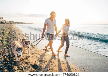 young caucasian couple walking...