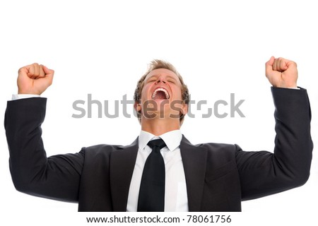 Young caucasian executive raises his arms overhead in celebration of his first successful deal