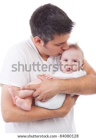 Young Caucasian father holding and kissing adorable baby, isolated on white