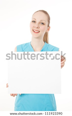 Young caucasian female fitness model holding a blank white sign - stock photo