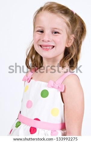 Young Caucasian girl in a polka dot dress