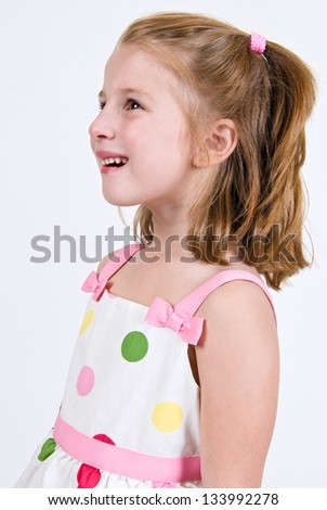 Young Caucasian girl in a polka dot dress