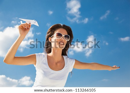 Young caucasian girl with two paper plane in the hand
