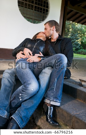 stock photo young caucasian heterosexual couple spending time together at the park sitting on the steps of a 66796216 - Effortless Programs For Latin brides world Revealed