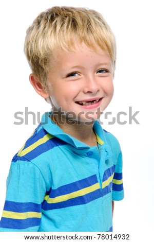 Young caucasian kid smiles for a portrait in studio, isolated on white