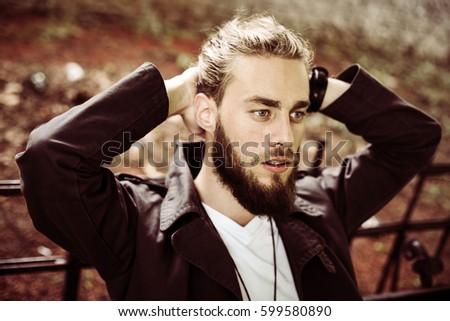 Young Caucasian man enjoying outdoor.  #599580890