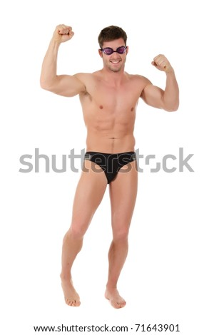 Young caucasian man swimmer with hands up wearing goggles. Victorious moment. Studio shot. White background