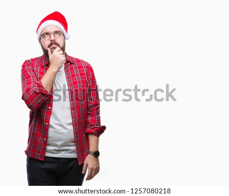 c3fa2b9b1cf16 Young caucasian man wearing christmas hat over isolated background with hand  on chin thinking about question