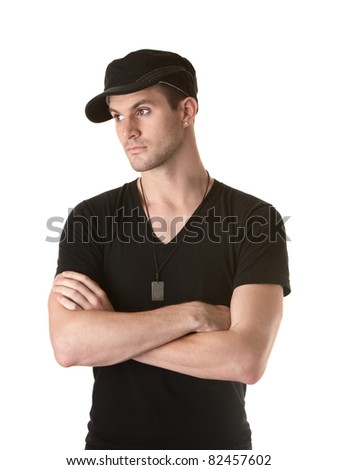 Young Caucasian man with arms folded over white background