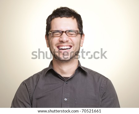 Young caucasian man with glasses laughing