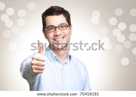 Young caucasian man with glasses showing thumbs up