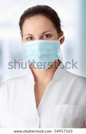 Young caucasian nurse in mask