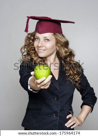 Young caucasian student with an apple