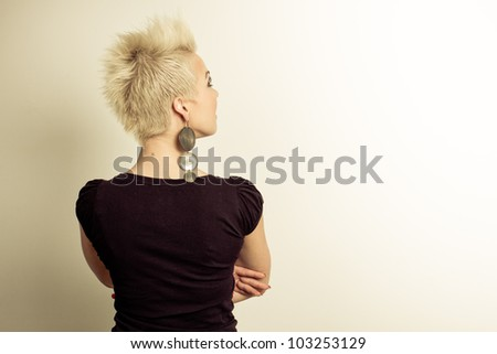 young caucasian woman back portrait - colorized photo