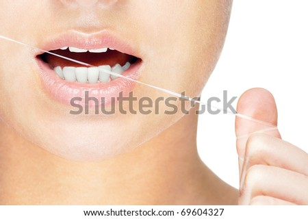 Young caucasian woman flossing her teeth , close up , isolated on white background