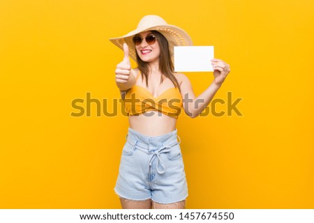 Young caucasian woman going to shopping Young caucasian woman ready to go to the beach with a placard #1457674550