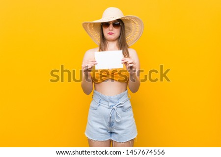 Young caucasian woman going to shopping Young caucasian woman ready to go to the beach with a placard #1457674556