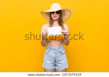Young caucasian woman going to shopping Young caucasian woman ready to go to the beach with a placard #1457674559