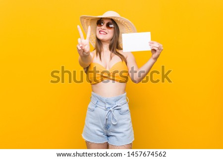 Young caucasian woman going to shopping Young caucasian woman ready to go to the beach with a placard #1457674562