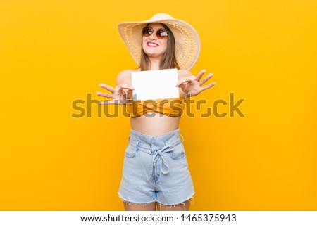 Young caucasian woman going to shopping Young caucasian woman ready to go to the beach with a placard #1465375943