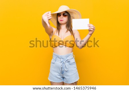 Young caucasian woman going to shopping Young caucasian woman ready to go to the beach with a placard #1465375946
