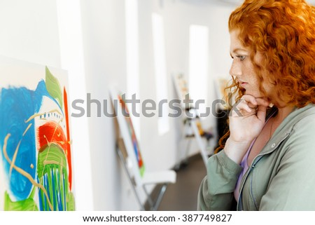 Young caucasian woman in art gallery front of  paintings #387749827