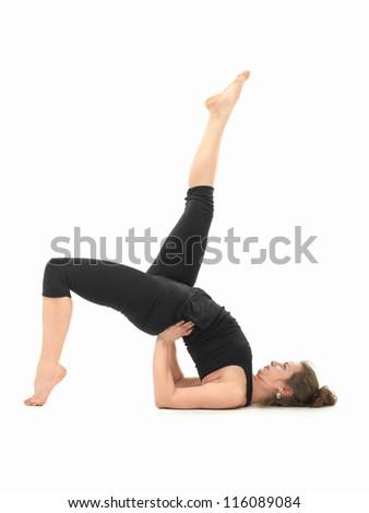 young Caucasian woman in balancing yoga pose
