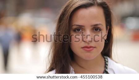Young caucasian woman in city face portrait #455100538