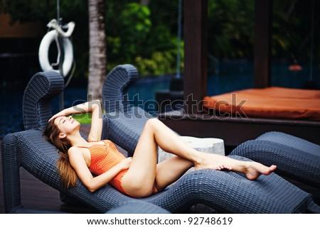 Young caucasian woman near swimming pool