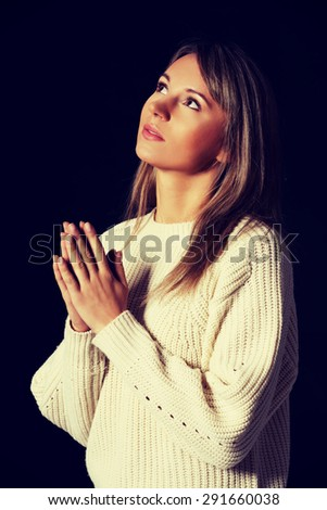 Young caucasian woman praying to Jesus