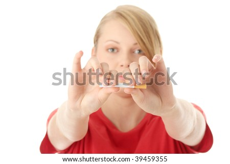 Young caucasian woman quiting smoking isolated
