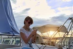 Young caucasian woman sailor enjoying summertime.
