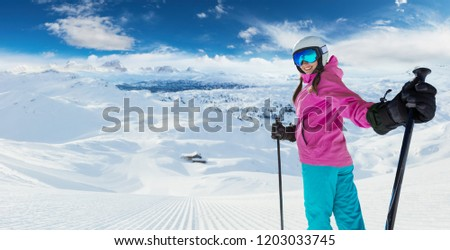 Young caucasian woman skier in European Alps. Winter sports and leasure activities