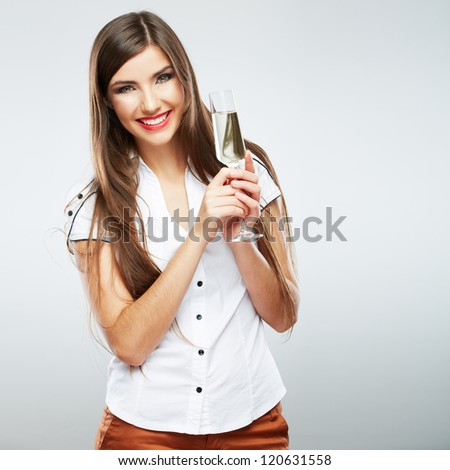 Young celebrating woman . Beautiful model portrait isolated over studio background hold wine glass