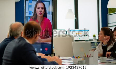 Young ceo speaking to camera during virtual business video presentation for business partners. Confident businesswoman talking to web cam streaming webcast training, doing online conference call.